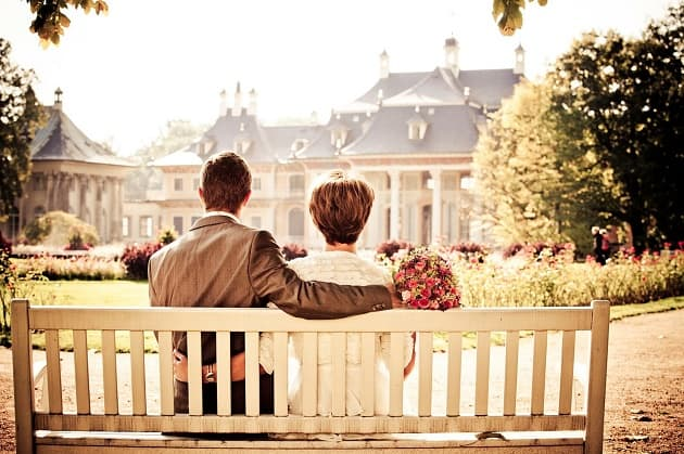 Wedding couple sat on a bench