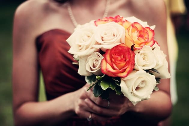Holding a wedding bouquet