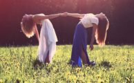 Two girls in a sunny field