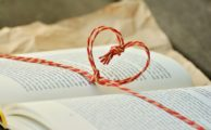 An open book with a heart