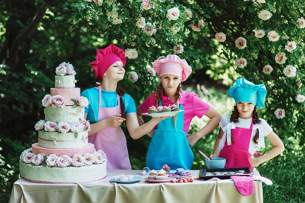 Children serving cakes